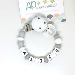 https:www.apersonnaliser.frwp contentuploads2020accroche tetine a personnaliser forme elephant blanc silicone prenom