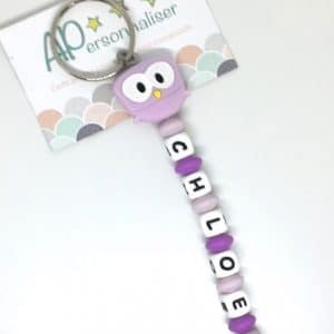 https:www.apersonnaliser.frwp contentuploads2020porte cles a personnaliser forme hibou violet silicone prenom